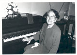 E. Mai Saunders at the piano