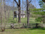 Sam Houston Schoolhouse: view of house with rail fence