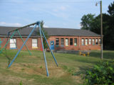 Green McAdoo school: rear view with playground