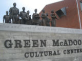 Green McAdoo School: statues of striding students