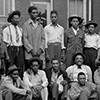 Group of African American men in front of the County Clerk's office