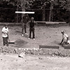 Unidentified Men Setting Up a Rolley Hole Marble Yard on Bud Garrett's Property